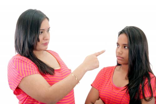 Two sisters arguing over a family problem