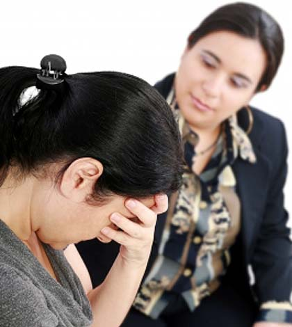 A woman sharing her family problems with a counselor