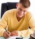 A writer writing happily to win contest
