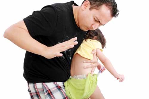 Father using spanking to discipline kid