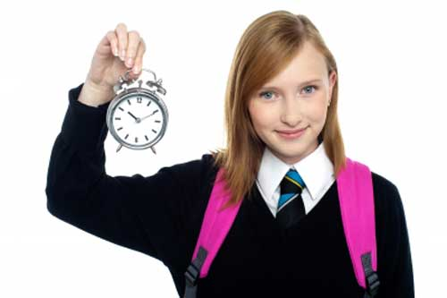 Girl with clock in hand telling importance of time