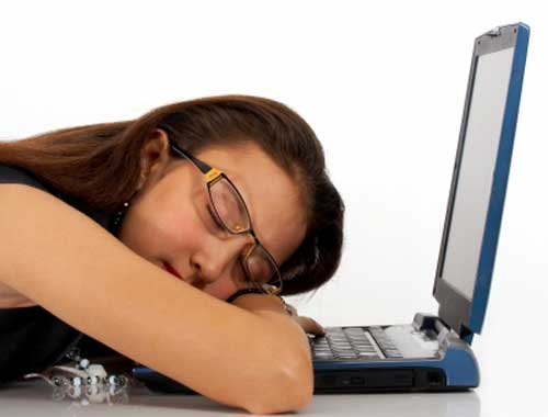 Girl sleeping on laptop after excessive use of social media