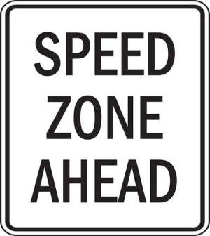 A site speed test sign board with speed zone ahead written