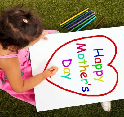 Child making Happy Mother's Day card for mom