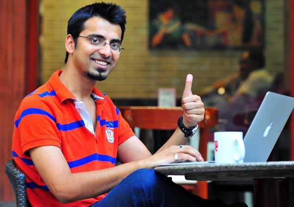 Harsh Agrawal giving interview on laptop