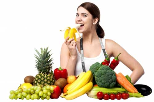 Girl eating fruits and vegetables for healthy lifestyle