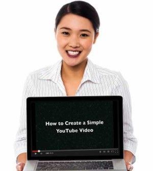 Girl showing how to make simple youtube video on laptop