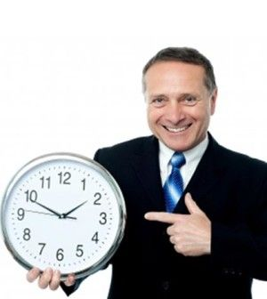 Man showing work hours in a week on clock