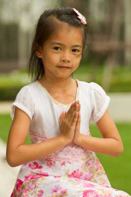 A girl praying for peace on earth