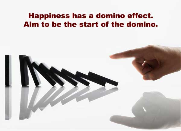 Man pushing the first domino to create the domino effect.