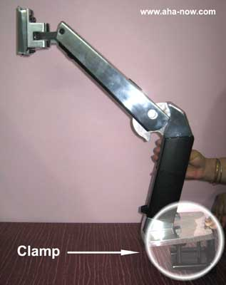 Workstation arm with clamp