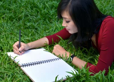 A woman author writing a book