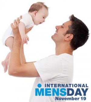 Father holding baby in hands and playing
