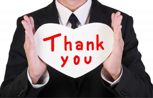 Thanking Thanksgiving with a Thank You card in hand
