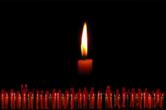 Image of candle with black background and kids as flames at bottom