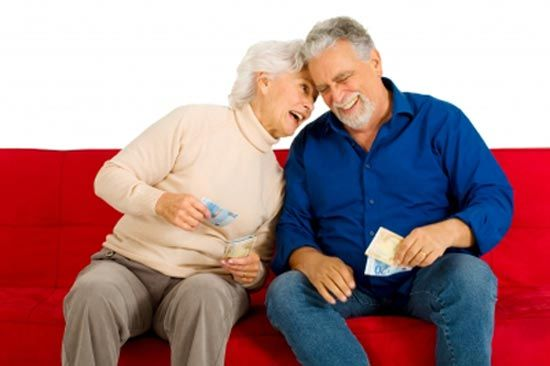 Old man and woman with money in hand and happy