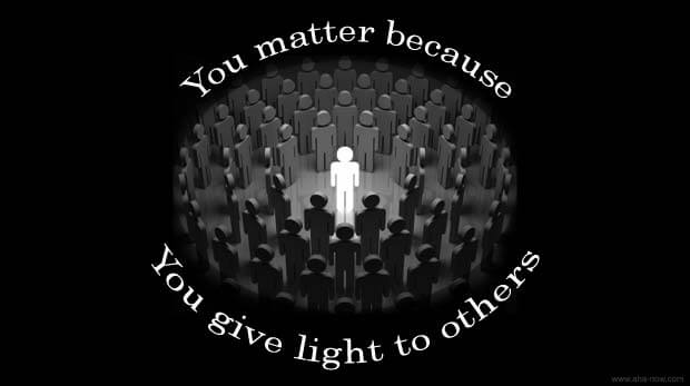 A man in the center spreading light to people around.