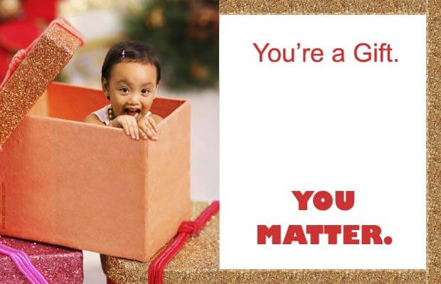 A baby inside a gift box and a quote that you matter.