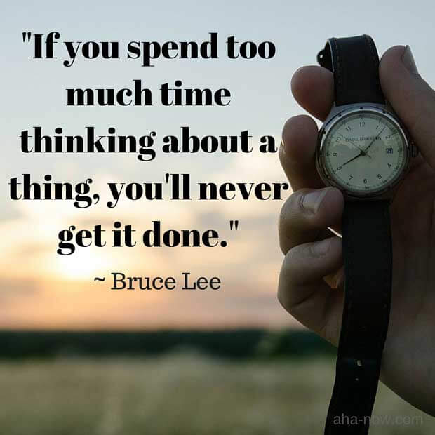 A person holding a watch in hand with a background of sunset and a quote