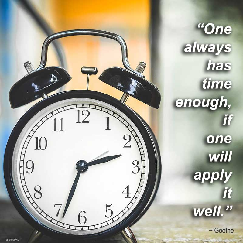 A clock and a quote about utilizing time.