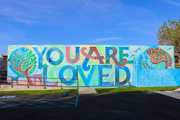Mural on the wall with you are loved written on it