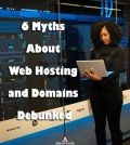 Woman with laptop in hand standing before servers debunking the web hosting myths