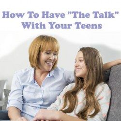 Mother having the talk with her teen daughter sitting on sofa