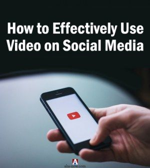 A person's hand scrolling mobile screen for video on social media