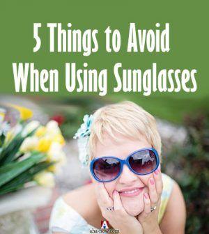 A woman using sunglasses