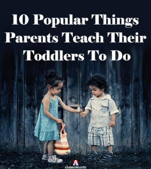 Two toddlers interacting as taught by parents